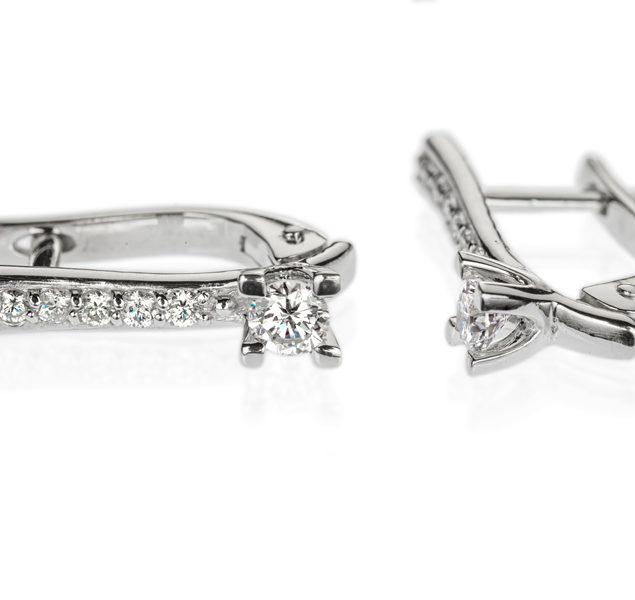 Taurus сережки з білого золота з діамантами E0633 - Фото 1
